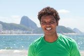 Happy man from Rio de Janeiro at Copacabana beach — Stock Photo