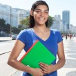 Standing latin student with long dark hair in the city — Stockfoto #82772632