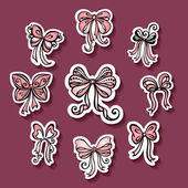 Vector Set of Stickers with Ornamental Holiday Bows — Stock Vector