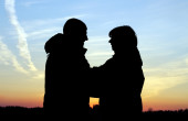 Couple at sunset — Stock Photo