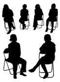 Sitting women silhouettes — Stock Vector