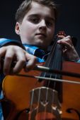 Young Cellist playing classical music on cello — Stock Photo