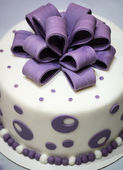 Cake with violet decoration — Stock Photo
