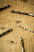 Drill bits on wooden table — Foto de Stock