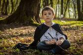 Boy with black cape — Stock Photo
