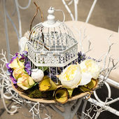 Flowers in cage — Stock Photo
