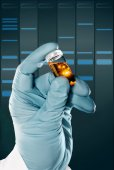 Hand holds a liquid sample in  vial — Stock Photo