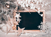 Black chalkboard with winter decorations — Stock Photo