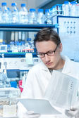 Young scientist or tech works in  lab — Stock Photo