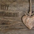 Merry Christmas! Wooden heart — Stock Photo #53803489