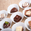 Row of chocolate pralines — Stock Photo #58051155
