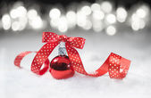 Red bauble with ribbon — Stok fotoğraf