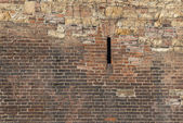 Old brick wall with wild stone — Foto Stock