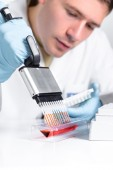 Scientist with multipipette — Stock Photo