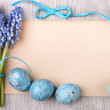 Ribbons and Easter eggs and flowers — Stock Photo #65767761