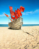 Traditional fisherman boat on a sandy shore — Stock Photo