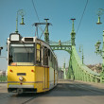 Historic tram on Freedom Bridge in Budapest — Stock Photo #76016153