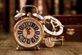 Alarm clock showing five to twelve. — Stock Photo