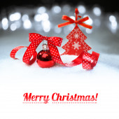 Red Christmas bauble on winter background — Stock Photo