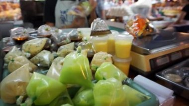 Local people buying fresh vegetable and salad from vendors market — Stock Video