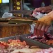 Butcher selling fresh meat in local Asian market, unhygienic food preparation — Stock Video #54918141