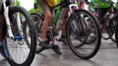 Abstract biking tournament at start line, shot of a group of race cyclists — Video Stock