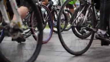 Abstract biking tournament at start line, shot of a group of race cyclists — Stock Video