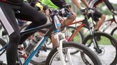 Abstract biking tournament at start line, shot of a group of rac — Foto Stock
