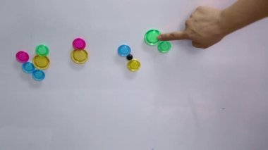Hand categorise colourful magnet on magnetic board — Video Stock