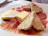 French appetizer platter, foi gras and parma ham — Stock Photo