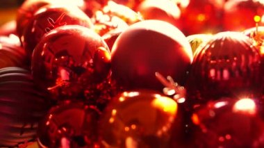 Close up, Shiny red and gold Christmas ball mistletoe ornaments in morning new year light — Stock Video
