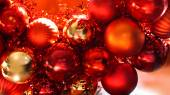 Red and gold christmas ornaments background — Stockfoto