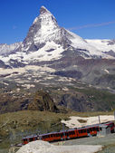 Zermatt Switzerland, green car-free city electric train — Stock Photo