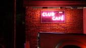 Club and cafe neon light pink sign — Stock Photo