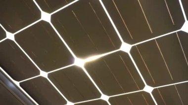 Sun shine through solar cell roof — Stock Video