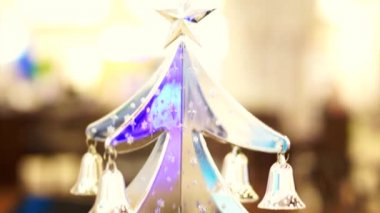 Christmas time silver ornament, tree, reindeer and bell hanging on a tree — Stock Video