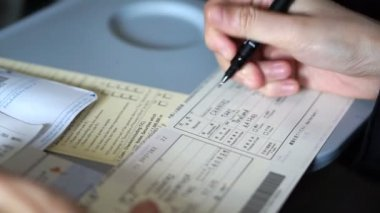 Hand filling custom immigration form — Стоковое видео