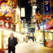 OSAKA, JAPAN - MARCH 2015: Shops area lights with Tsutenkaku Tower background, old classic shopping district area in Osaka, Japan. — Stock Video #77304422