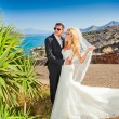 The lovely young couple beautiful woman from handsome man relating to the beautiful Greek landscape — Stock Photo #66630911