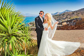 The lovely young couple beautiful woman from handsome man relating to the beautiful Greek landscape — Stock Photo