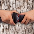 Save world concept, close up two hand use safety belt on wood taxture  blur  background — Stock Photo #65517023