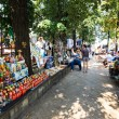 Постер, плакат: Tourists and locals looking at the stalls at Chisinau flea marke