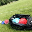 Soccer (football) training equipment next to a bag with the team — Stock fotografie #52569721