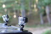 Gopro Hero 3 Cameras on the hood of a car in nature. Gopro went — Stock Photo