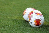 Europa League balls on the field during the training of PAOK in — Stock Photo