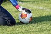 Greek Superleague Brazuca (Mundial) balls on the goalkeeper's ha — Stock Photo
