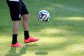 Footballer's feet in action with Greek Superleague Brazuca (Mun — Stock Photo