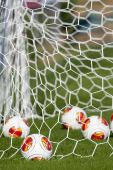 THESSALONIKI, GREECE, OCTOBER 22, 2013: Europa League balls in net during Paok training in Thessaloniki, Greece. — Stock fotografie