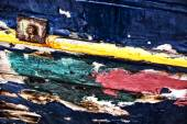 Detail of an old fishing boat rotting in the small harbor in Gre — Stock Photo