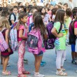 Students with their backpacks. First Day of school for the stude — Stock Photo #53933433